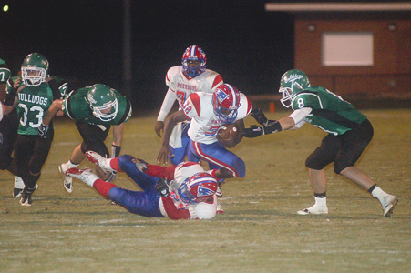 Michael Rodgers/The Luverne Journal -- Samuel Monroe carries the ball for the Patriots late in Friday's lopsided win over Brantley.