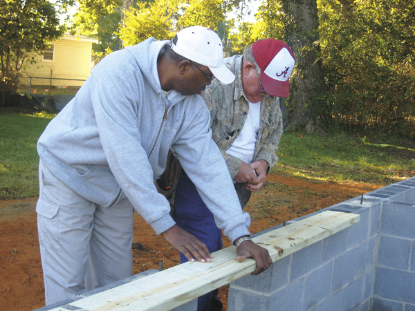 Jason Cannon/The Demopolis Times -- Freddie Charleston and Buddy Cost work on a project in downtown Demopolis.