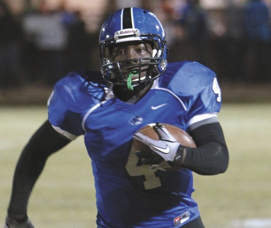 Michael Clements/The Times -- DaMarcus James rushed for 227 yards and three touchdowns and threw a touchdown Friday night.