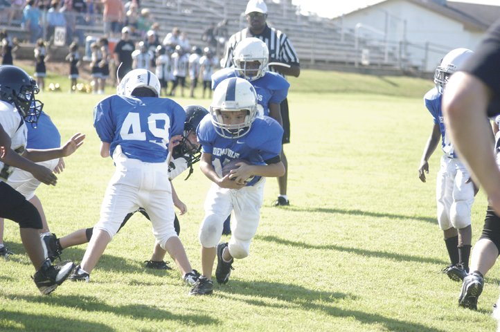 Jason Cannon/The Times -- Mac Logan rushes the ball during a game earlier this year.