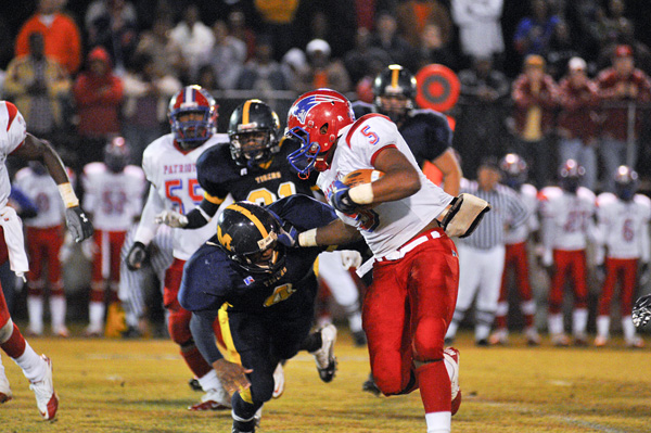 Michael Rodgers/The Greenville Advocate -- Kendarius Fritts stiff arms a McKenzie player.