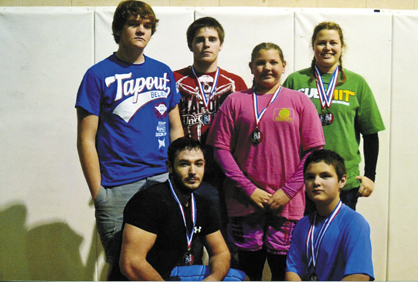 Members of the Demopolis Fitness MMA team (top row, from left) are Jack Vann, Jacob Dill, Mackenzie Dill and Alli Boxmeyer. On the bottom row are Michael Blanton and Patrick Hall.