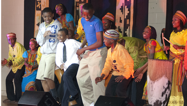 John Essex students perform with members of the Watoto Children's Choir.