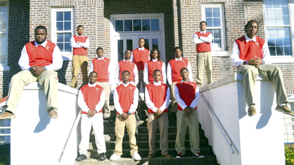 The Linden basketball team won their area tournament Monday night with an 81-71 victory over Sunshine High School. Pictured here on the steps of Linden High School are the members of the 2013 LHS Patriot basketball team. Front row seated on ledge left to right, Chris Rogers and Kynard Craig; second row left to right, Jarius McGhee, Jalen Lewis, Terrance Sanders and Jaman Evans; third row left to right, Nicholas Rogers, Anthony Robinson, Shauka Reese and DeQuinton Bell; back row left to right, Jeffery Stacey, Savan Parker and Imoras Agee.