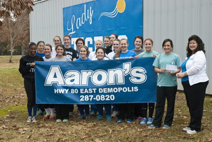 Aaron's donated to the DHS softball program Thursday, Feb. 7. Connie Burdett from Aaron's hands the donation to the team.