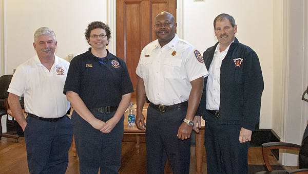 Mobile Fire and Rescue officers held a seminar for Demopolis city officials this past Thursday. Shown are Doug Cooper, Sherry Crush with Battalion Chief Talmus Williams and Fire Chief Tommy Tate.