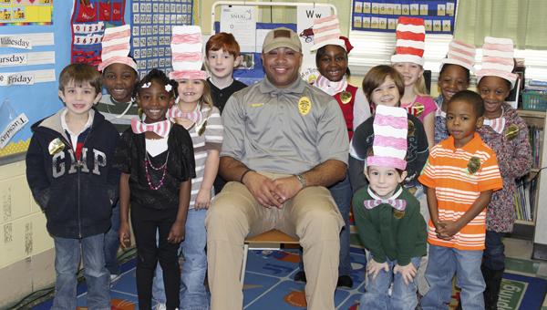 Westside's School Resource Officer Marcus Williams read to Amanda Harrison's kindergarten class.