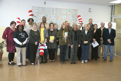 Volunteers prepare to read to students Friday morning at Westside Elementary School.