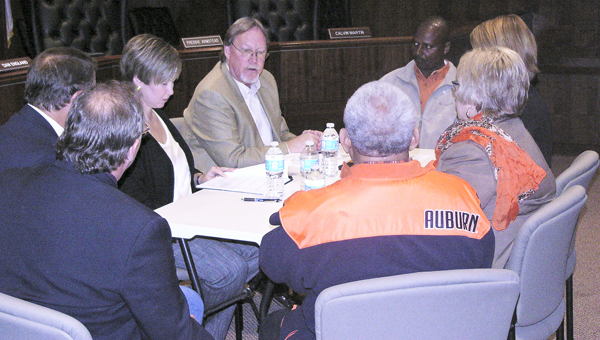 Frank Dobson explains to members of the Marengo County Commission, Brenda Tuck and Kathryn Friday how the grant process will work and the timetable that they are looking at for the funds.