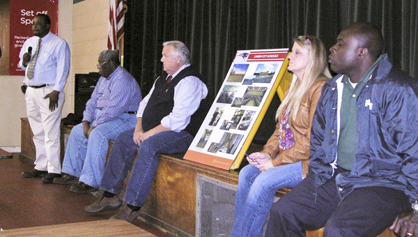 Superintendent George Baldwin addresses citizens on the Linden Board of Education's concerns about George P. Austin Junior High School. W ith him on stage are board chairman William Curry; and board members, Dr. Bobby Hopper, Nellie Sullivan and Robert Alston Jr.