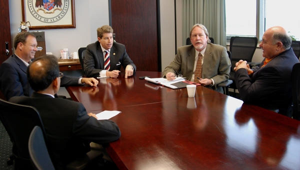 ADECA Director Jim Byard Jr., center, speaks to officials from Demopolis. Clockwise from left are ADECA's Shabbir Olia, Demopolis city council member Bill Meador, Byard, Frank Dobson of the Alabama Tombigbee Regional Commission and Demopolis Mayor Mike Grayson.