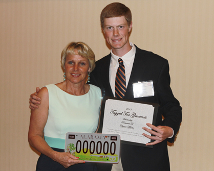 """Demopolis' Chance Martin is presented with the """"Tagged for Greatness"""" scholarship by the 2012 president of the Alabama Cattlemen's Association, Donna Jo Curtis."""