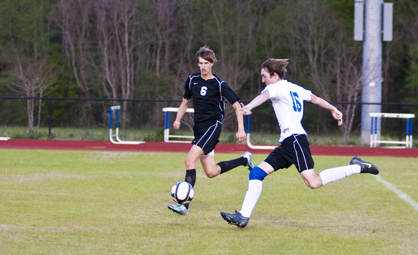 Demopolis' Austin Brooks attempts a shot in the first half of the game against Holy Spirit on Wednesday night.