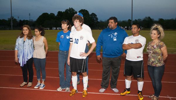 Three seniors were honored at the DHS soccer game Wednesday night against Holy Spirit. Myra Cardenas, the team's manager and head ball girl, is shown with her mother, Florina Miranda. Nathan Hay is shown with his parents, Larry and Cindy Hay. Jace Revis is shown with his parents, J.R. Revis and Tina Pope.