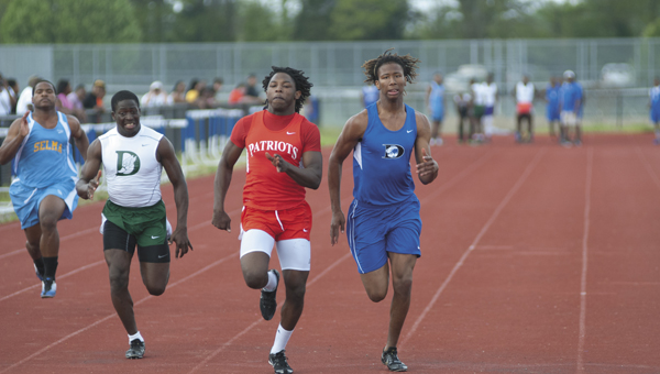 Demopolis' Rodney Harper and Linden's Marquise Shelton race neck-and-neck to the finish the one of the 100-meter dash heats.
