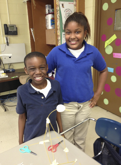 Jamar McCoy and Paige Williams proudly show off their spaghetti tower that won the 4H Innovators' competition by being a freestanding tower which supported a marshmallow on top.