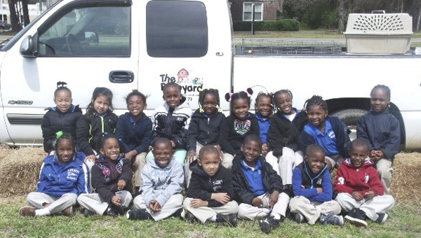 """Pictured """"down on the farm"""" with The Barnyard are Linden Elementary students in Mrs. Martin's and Ms. Williams' Pre-K class, front left to right,  Shaukala Reese, Parys Wolf, Jeremiah Johnson, Tony Thomas, Cameron McMullen, Maurice Chaney, and Kortavion Richardson; back left to right, KyNiyah Brown, Ruby Munoz, Casey McKinney, Mekil Strong, Jasmine Banks, Tori Bartee, Charmigne Alvis, Destiny Zanders, Kristian Pond, and Jakavyon Burden."""