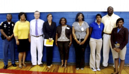 Linden High School students participated in an assembly recently talking about the effects of underage drinking. Pictured after the assembly, left to right, are State Trooper Charles Dysart, MADD Coordinator Pamela Morton, Chief Juvenile Probation Officer Darren Glass, Probate Judge Laurie Hall, WAMHC Prevention Coordinator Sherron Hatcher, WAMHC Intern Christine Dade, LHS Senior Class President Keandra Lewis, LHS Principal Dr. Timothy Thurman and LHS Junior Class President Jeannettea Taft.