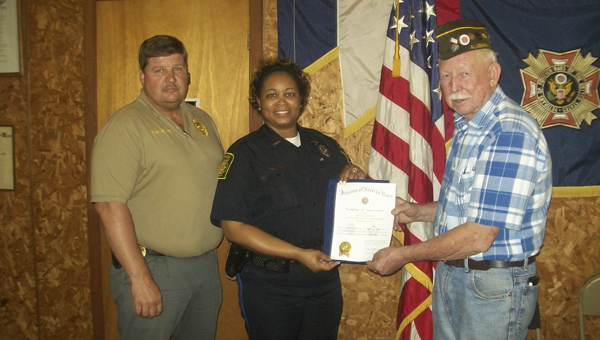 Linden Police Department D.A.R.E. Officer Sonja Myles was presented with the VFW Edgar Hoover Award. Shown from left are Linden Police Chief Scott McClure, Myles, and Billy Drake, of the local VFW Post.