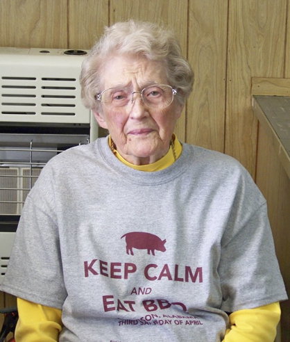 """Lucretia Norris, a lifetime member of Jefferson Community Club, dons the club's """"Keep Calm and Eat BBQ"""" t-shirt."""