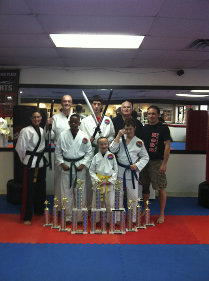 Members of the Ross Martial Arts Competition Team participated in the Decatur tournament on March 23. Shown on the front row are Cordell Washington, Charlie Duke and Brett Schroeder. Shown on the back row are Ronda Russell, Jake Duke, Tristen Fitz-Gerald, Ron Ross and Jay Russell.