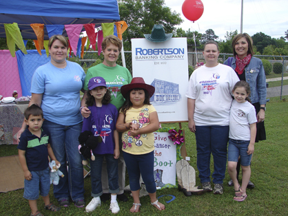 """The Robertson Banking Company team gave the """"boot to cancer"""" with a Western-themed booth."""