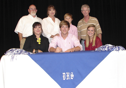 Mason Rogers, center, signed a baseball scholarship to Lurleen B. Wallace Community College. Shown are, front row, Jeremie Mayton, Rogers and Sidney Alyn Atkins; back row, Jerry Stewart, Paula Stewart, Hayes Atkins and Billy Rogers.