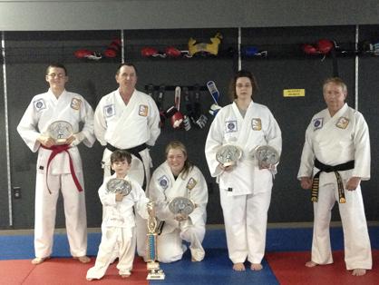 Alex Boxmeyer, Bob Barton, Logan Williamson, Allison Boxmeyer and Lisha Montelongo show off the awards they earned for Demopolis Taekwondo at the East Mississippi Championships.