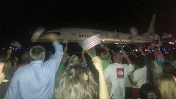 A large crowd gathered at the airport in Tuscaloosa to see 98 veterans take off to Washington, D.C., for an Honor Flight to see the memorials dedicated to them.