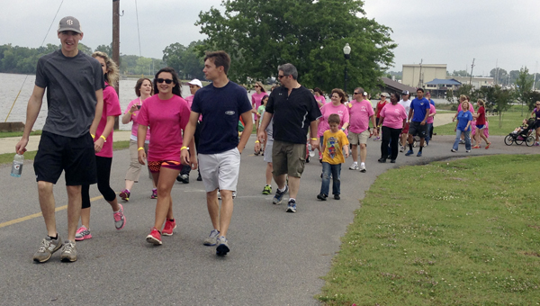 Supporters of Anna Coleman Yelverton walked 1-mile in her honor Saturday from the City Landing to the Public Square and back down Main Avenue.