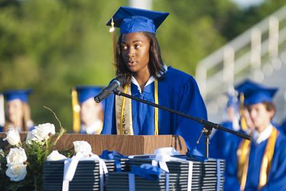 Alexis Jones, the class salutatorian, addresses her classmates during Friday night's ceremonies.