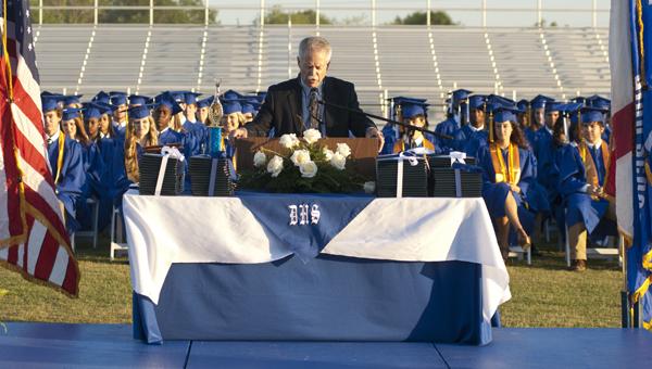 Demopolis High School principal Leon Clark addresses the graduates and everyone in attendance during the graduation ceremonies held Friday night at the football stadium.