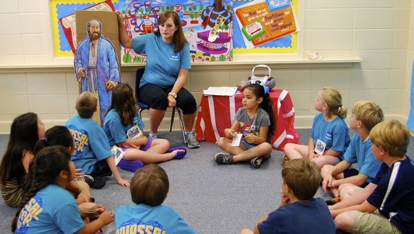 First Baptist Church in Demopolis kicked off Vacation Bible School this week. Shown in the photo is Betsey Stephens during Bible story time.