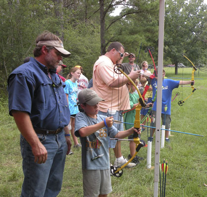 Vince Deas and his son, Bryant, are shown participating in the archery station during the 2012 event.