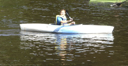Sara McVay kayaks on the river in the 2012 Feathers, Fins and Fur weekend.
