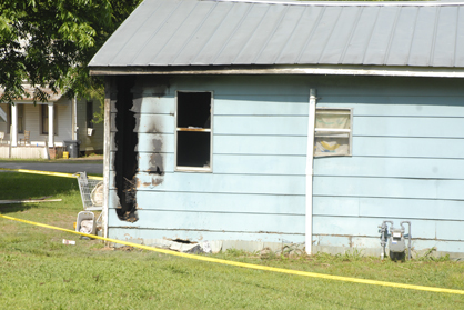 This home on East Lyon Street caught fire Sunday night, but firefighters were able to contain it in a back bedroom.