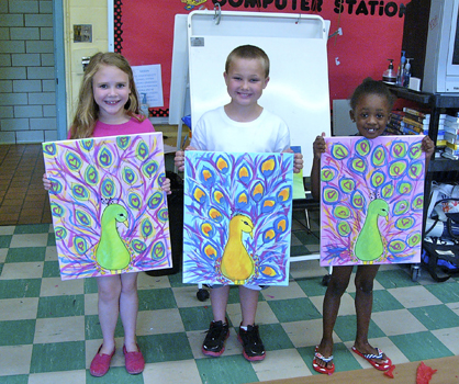 Students are shown holding their Art Week photos. Lauren Smith, John Robert Copeland and Taliah Issac were a part of the camp.