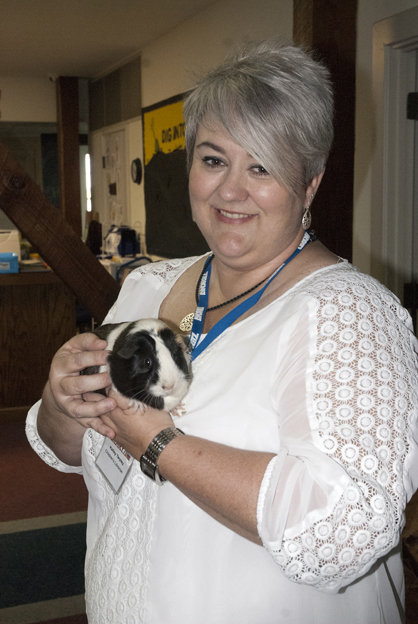 Children's librarian Kelley Tarpley with the library's newest staff member.
