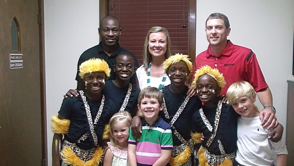 First United Methodist church host family Claire and Rodney Bell with children Jay, Cameron and Susanna are shown with assistant director William and Ugandan children James, Solomon, Paul and Vincent.