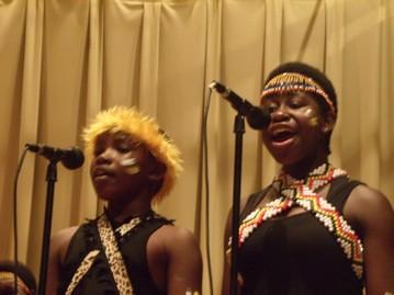 Ugandan choir members belt out a spiritual song Friday night.