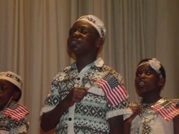 "Ugandan choir members pay tribute to America by singing, ""America, the Beautiful."""