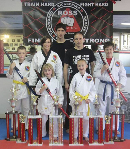 Ross Martial Arts brought home 15 trophies from a May 18 tournament at the Alabama Karate Circuit Open in Decatur. Pictured are members of the Ross Martial Arts Competition Team, from left to right, front row; Joanna Duke and Charlie Duke; back row, Sam Breightling, Ronda Russell, Tristen Fitzgerald, Jay Russell and Brett Schroeder.