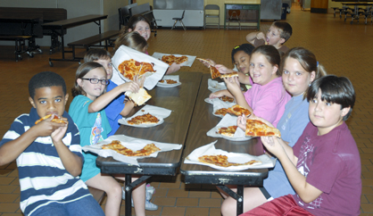 Students attending the Westside Elementary science enrichment camp enjoyed the pizza they made on Thursday.