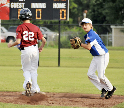 Henry Overmyer attempts a throw to first during Demopolis' game against Andalusia on Saturday in the 12U state tournament.