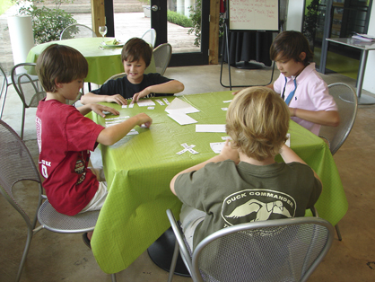 Camp participants learn how to set a table.