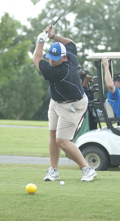 Demopolis head football coach Tom Causey tees off during the DHS football golf tournament Wednesday.