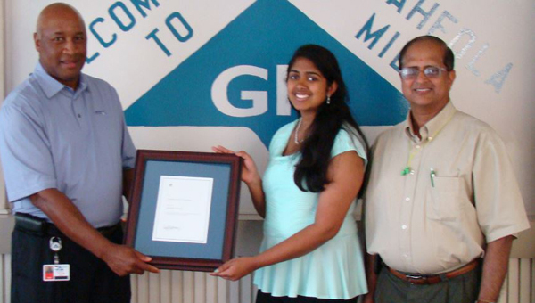 Shrikiriti Rajan, a senior at Sparkman High School in Harvest, is a recipient of a 2013 Georgia-Pacific Employees' Children Scholarship. Rajan, holding her $2,000 award with Naheola Mill Vice President Kelvin Hill, is standing next to her father, Sundararajan Padmanabhan, who works as an engineering manager at the Naheola Mill in Pennington. She plans to pursue a major in bioengineering and biomedical engineering at the University of Alabama in Birmingham this fall.