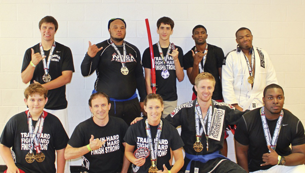 Members of the Ross Martial Arts Fight Team pose with their medals won at the Georgia State Championships. Pictured are, front, from left to right, Hunter Compton, Jay Russell, Ronda Russell, Daniel Alexander and Joe Morris; back row, Ty Harwell, Tony Nicholson, Tristen Fitz-Gerald, Robbie Gray and Franklin Richardson.