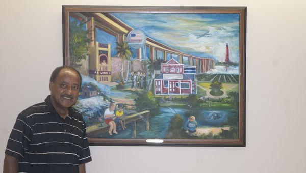 """Raleigh Bailey is shown with his painting, """"One-Martin,"""" at Bryan W. Whitfield Memorial Hospital. This and several other pieces of Bailey's art are on display."""