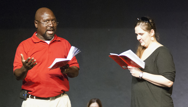 """Patrick George and Laura Clements rehearse for the Canebrake Players' production of """"Return to the Forbidden Planet."""""""